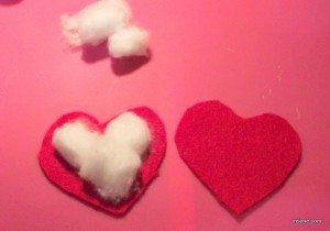 To make the hearts puffy I used cotton balls.  I also put them together the lazy/easy way: I hot glued them together.  Maybe next time I will get my needle and thread out.
