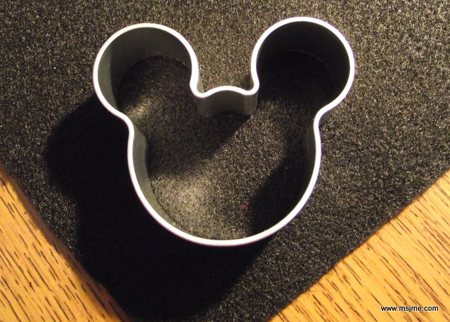 Use a cookie cutter for the shape and trace it.  Cut along the lines made.