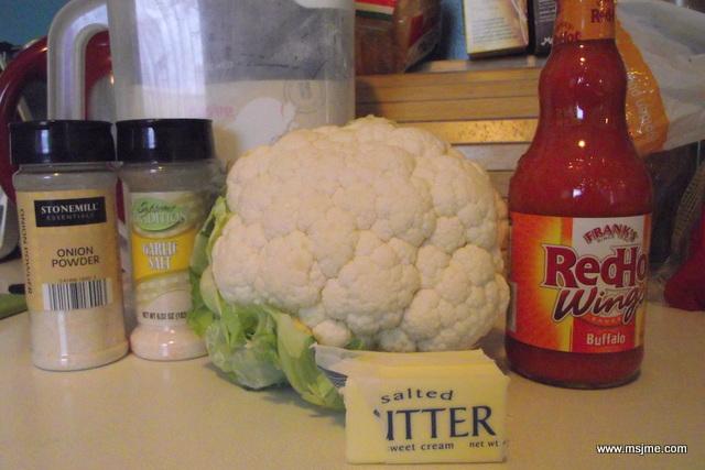 Ingredients: 1 head of Cauliflower (cut into pieces) 1/2 Flour 1/2 Water 1/4 tsp Garlic Salt 1/4 tsp Onion Powder 4 tbsp Franks Wing Sauce 3 tbsp Butter