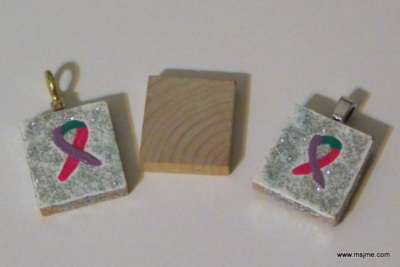 I hand-painted Thyroid Cancer ribbons onto Scrabble tiles for my friend and I.