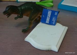 Materials needed: Plastic Toy Wood Plaque Paint Scissors E5000 or SuperGlue