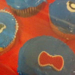 """I also made these adorable Doctor cupcakes. (Wish I would have remembered to take a better pic!). I bought the """"Geek"""" decoration at Target. You can also find them at Amazon."""