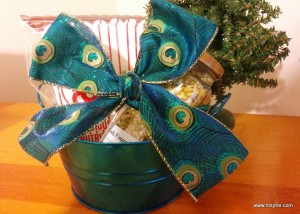 """I """"whipped"""" up this basket idea for Christmas 2015.  I found a small tin to put a jar of popcorn kernels and some popcorn boxes.  I re-packaged the kernels from a bulk buy and put it in a nice jar I prepared.  I placed a label on the jar with my favorite popcorn recipe and voila! all done."""